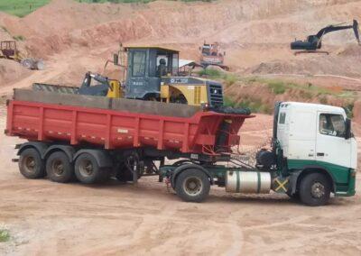 Distribuição de areia e pedra carga reta
