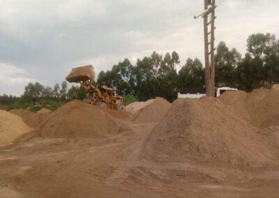 Distribuição de areia e pedra Campos